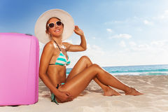 Happy woman with luggage on vacation Royalty Free Stock Photo