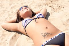 Happy woman is lying on the beach Royalty Free Stock Photography