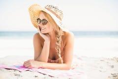 Happy woman lying on the beach Stock Photo