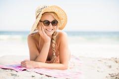 Happy woman lying on the beach Stock Image