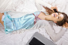 Happy woman lying on the bed Royalty Free Stock Photography
