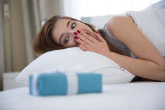 Happy woman lying on the bed Royalty Free Stock Image