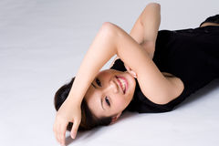 Happy woman lying on the floor Royalty Free Stock Photography