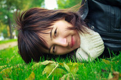 Happy woman lying on grass Stock Image