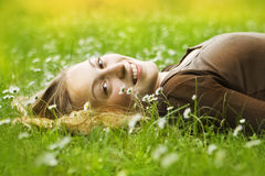 Happy woman lying in grass Stock Images