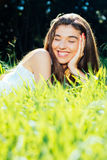 Happy woman lying in the grass Royalty Free Stock Photos