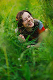 Happy woman lying in green grass Royalty Free Stock Images