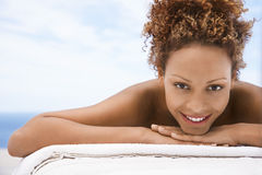 Happy Woman Lying On Massage Table Royalty Free Stock Photo