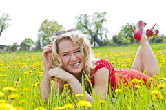 Happy woman lying in a meadow Royalty Free Stock Image