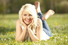 Happy woman lying on a meadow Stock Photography