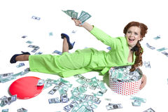 Happy woman lying with money in a box Stock Image