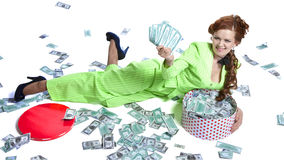 Happy woman lying with money in a box Royalty Free Stock Photos