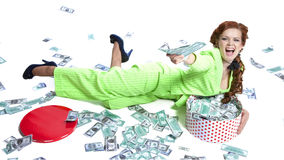 Happy woman lying with money in a box Royalty Free Stock Photo