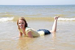 Happy woman lying in the water Royalty Free Stock Photography