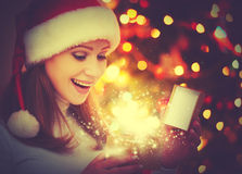 Happy woman with magic Christmas  gifts Royalty Free Stock Photos