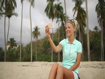 Happy woman makes selfie photo on the beach stock video footage