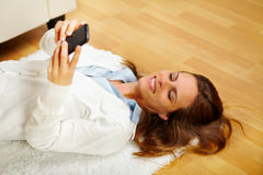 Happy woman making a call on the mobile phone Royalty Free Stock Photo