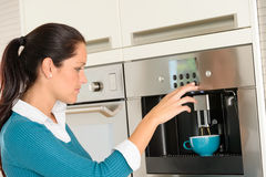 Happy woman making coffee machine kitchen cup Stock Image