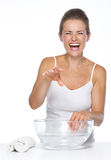 Happy woman making fun while washing hands in bowl with water Stock Image