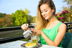 Happy Woman Making Green Tea Outdoors Stock Photography