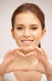 Happy woman making heart gesture Royalty Free Stock Photo