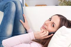 Happy woman making a phone call Stock Photography