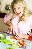Happy woman making salad Royalty Free Stock Photography
