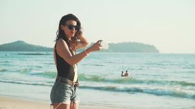 Happy woman making selfie on the beach stock footage