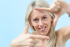 Happy woman making selfy photo frame around her face Stock Photos