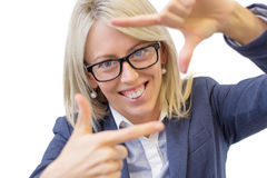 Happy woman making selfy photo frame around her face Stock Image