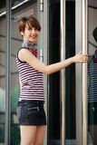 Happy woman at the mall doorway Stock Photos