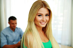 Happy woman with a man on background Royalty Free Stock Photo