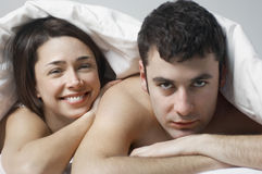 Happy Woman With Man In Bed Royalty Free Stock Photo
