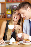Happy woman with man in café Royalty Free Stock Image