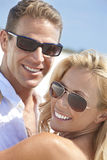 Happy Woman Man Couple In Sunglasses At Beach Stock Image