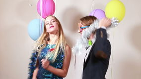 Happy woman and man dancing in photo booth. Happy beautiful woman and smiling man dancing in party photo booth stock footage