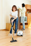 Happy woman and man doing housework Royalty Free Stock Photos