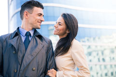 Happy woman and man flirting outdoors Stock Photography