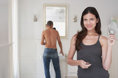 Happy Woman With Man Getting Ready In Bathroom Stock Photo