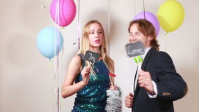 Happy woman and man in love in photo booth. Happy beautiful woman and smiling man in love in party photo booth stock footage