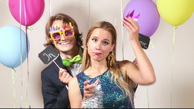 Happy woman and man in love in photo booth stock footage