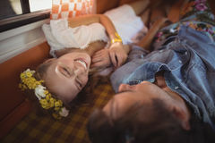 Happy woman with man lying down in van Royalty Free Stock Images