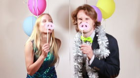 Happy woman and man in photo booth. Happy beautiful woman and smiling man dancing in party photo booth stock video