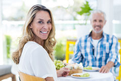 Happy woman with man in restaurant Stock Photos