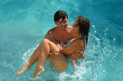 Happy woman and man in water pool Stock Photos