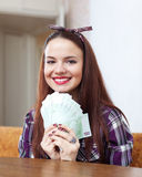 Happy woman with many euro Stock Image