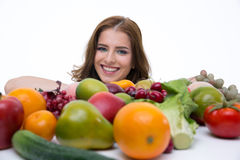Happy woman with many fruits Royalty Free Stock Image