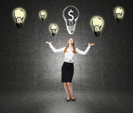 Happy woman and many light bulb sketches Royalty Free Stock Photo