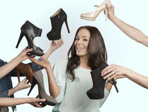 Happy woman with many shoes Stock Image
