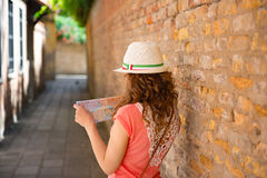 Happy woman with map in Venice Royalty Free Stock Images